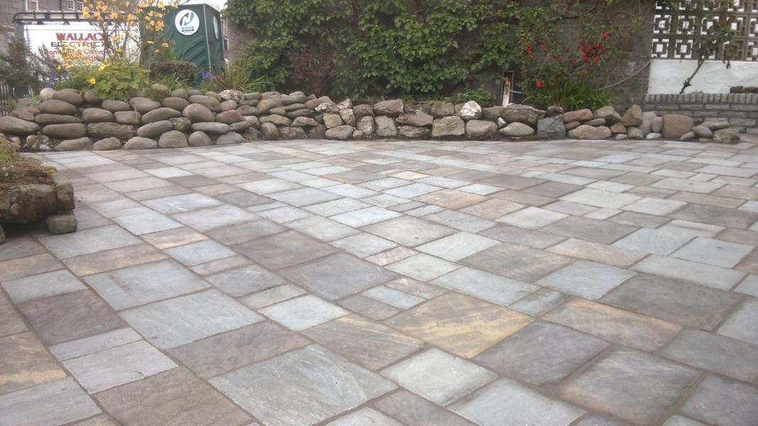 After - The finished garden and driveway laid with slabs